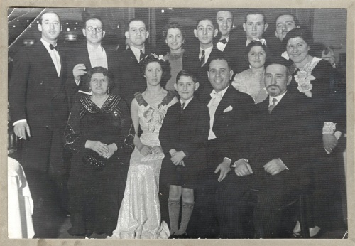 Family Reiss (circa 1938) Back row: Brothers Morry, Solly, Charlie, Alf, Joe & my grandfather Sam (separated by Alf's wife Bella & bar mitzvah Lionel Becker). Middle row: My mother Norma & grandmother Leah. Front row: My great-grandmother & grandfather Chana & Naftali, flanking Reiss sister Sadie, her husband Jack & son Alan Becker.