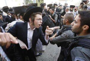 Haredi protesters confront police