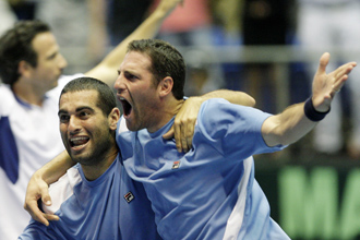 Andy Ram and Yoni Erlich celebrate victory over Russia